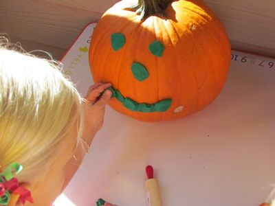 Playdough pumpkin decorating...
