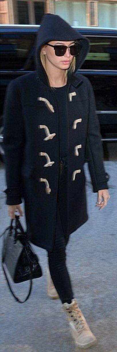Who made Hailey Baldwin's blue toggle coat, black handbag, sunglasses, and tan ankle boots?