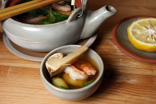 """Matsutake Dobin Mushi - Matsutakes are wonderfully fragrant pine mushrooms, and dobin (""""teapot"""") mushi (""""steamed"""") is a soup steamed in a small teapot. Put these two words together, and you have matsutake dobin mushi, a nourishing mushroom soup. Each teapot holds an individual serving of soup. The dashi-based broth is delicate, and the soup contains thin slices of chicken, shrimp, ginkgo nuts, and mitsuba (honewort.)......"""