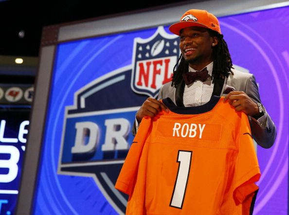 Bradley Roby of the Ohio State Buckeyes poses with a jersey after he was picked #31 overall by the Denver Broncos during the first round of the 2014 NFL Draft at Radio City Music Hall on May 8, 2014 in New York City