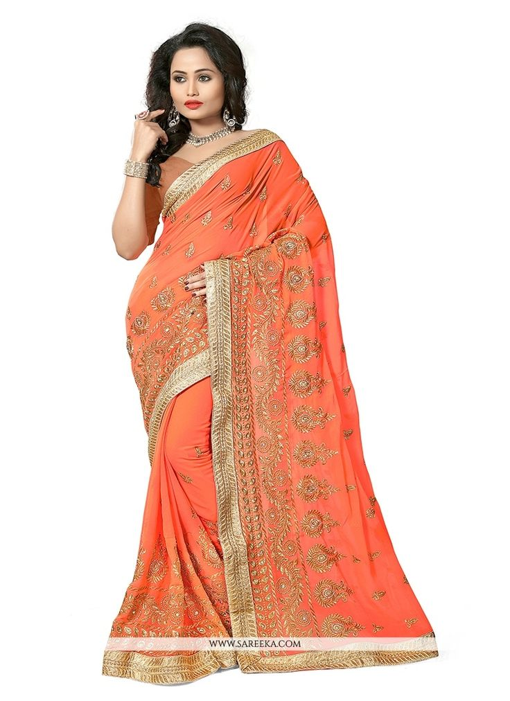 Sensible colors and excellent designs and romantic moods are reflected with an alluring style. Make the heads turn when you costume up with this pretty orange georgette traditional  saree. Beautified ...