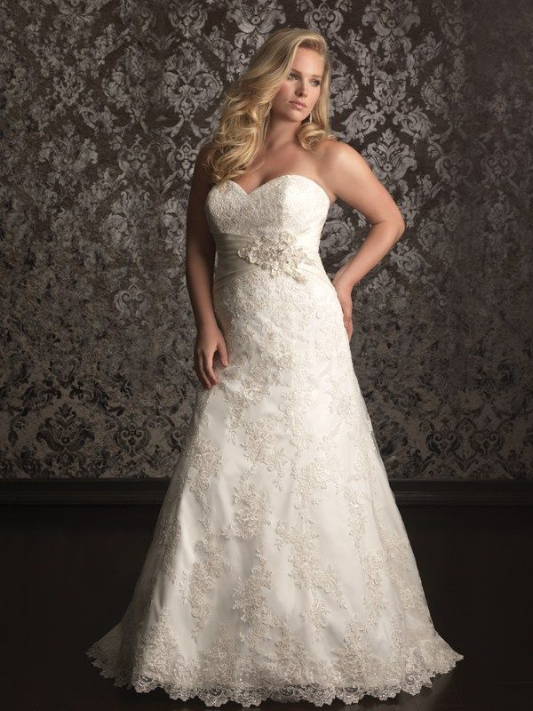W311 Allure Women Bridal Gown - Simple and sophisticated. This stunning wedding dress is created from soft satin. The sweetheart neckline is flattering while ruching continues throughout. A lace-up back ensures a perfect fit.