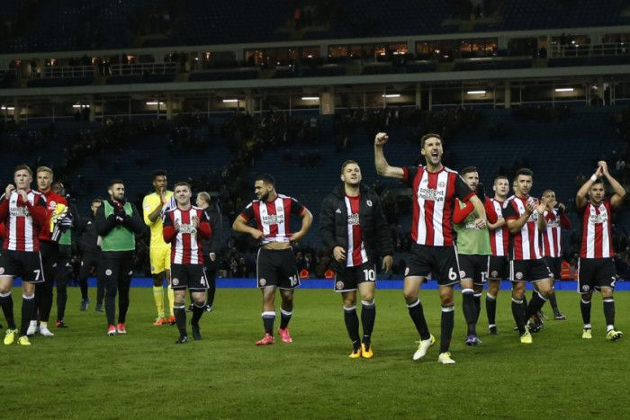 Oct. 27th. Sheffield United players celebrate a 2-1 away win over Leeds United