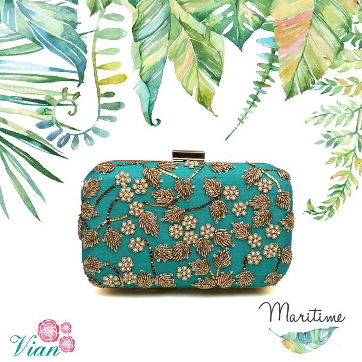 Vian Label's Maritime Clutch One of our all time favourite colors.. The peacock blue and green combination. On a beautiful raw silk base, this clutch has a floral pattern in zardozi and pearls. A very traditional pattern, this bag will brighten up any outfit.