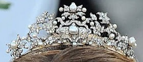 The diamond and pearl Antique Corsage Tiara has a history that passes it through the hands of Queens from three different countries. Queen Victoria of Sweden wore it as brooches. The piece was inherited by Queen Ingrid of Denmark (Victoria's granddaughter). Ingrid set the brooches as a tiara and gave it to her daughter, Princess Anne-Marie, as an 18th birthday, and she took it when she became Queen of Greece.
