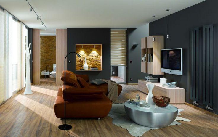 Sypialnia i pokój TV zostały częściowo oddzielone. Wnękę w ścianie wykorzystano jako  główny element ozdobny pomieszczenia. Fot. Jung