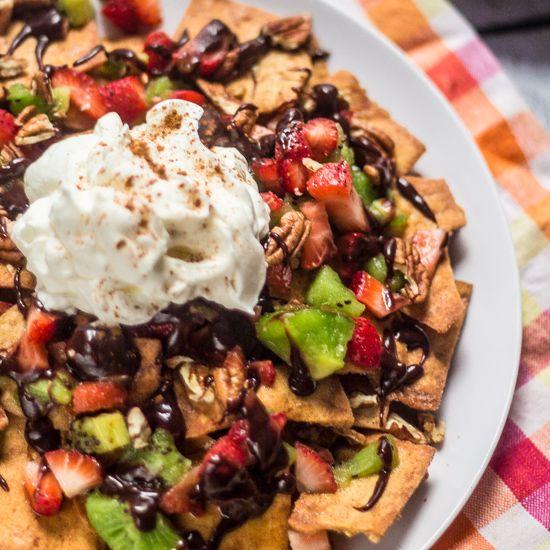 Dessert Nachos Recipe Desserts with pita chips, strawberries, kiwi, Nutella, heavy cream, heavy cream, vanilla extract, confectioners sugar, chopped pecans