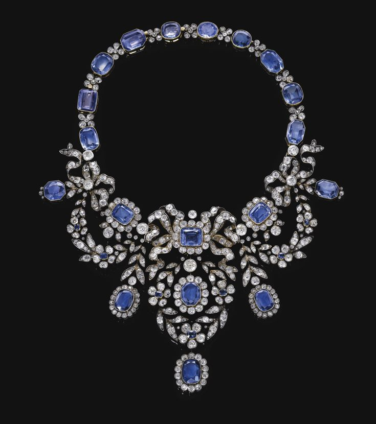 Sapphire and diamond necklace, late 19th century. Of bow and foliate swag design, millegrain-set with variously cut sapphires and circular-, single-, cushion-shaped and rose diamonds, length approximate 340mm, detachable into six pieces. - Sotheby's