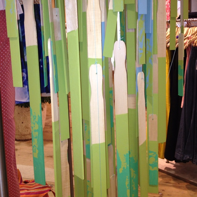 Anthropology display in Portland: wooden paint sticks tied together to create a hanging waterfall display. So clever!!