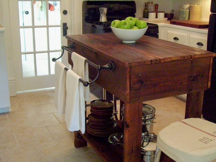 "I love the double towel rack and the solid ""heft"" this piece carries, giving a nice grounding effect. From Our Vintage Home Love: How To Build A Rustic Kitchen Table Island."