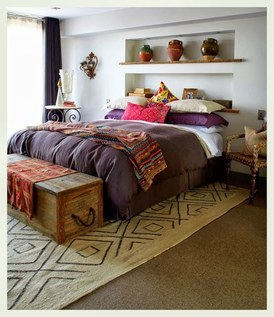 No head board over the bed - recessed wall on top of the bed.