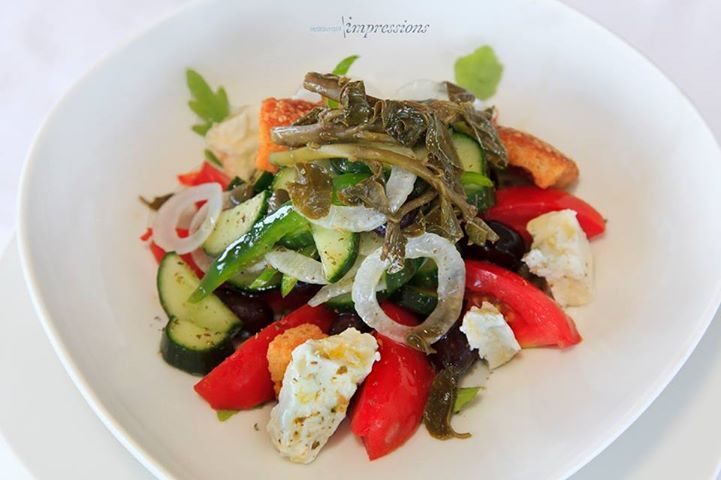 On a warm and sunny day after sunbathing what is better than a Greek salad with caper leaves, barley rusks and Agrafa feta cheese @ Impressions ? Maybe accompanied with a chilled glass of white wine ?