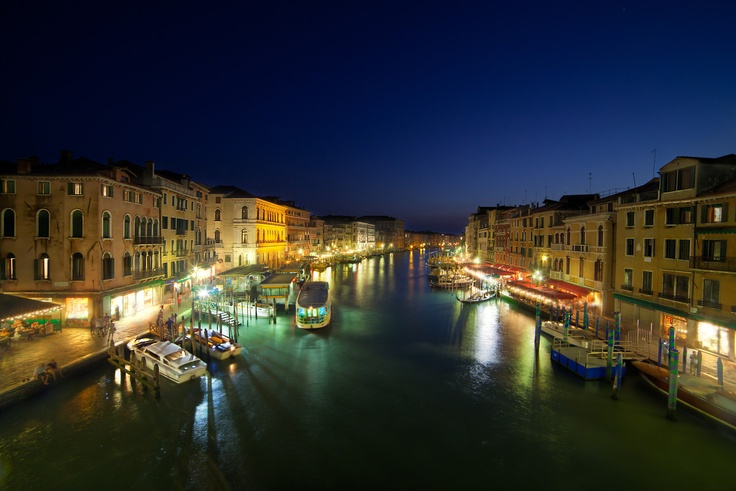 Grand Canal in Venice, Italy. Shortly after dusk it's very hard to get a good spot on the Rialto bridge -- everyone is standing by the barrier and either watch the canal or take photos of their girlfriends. I was fortunate to find a place almost in the middle to take this shot.