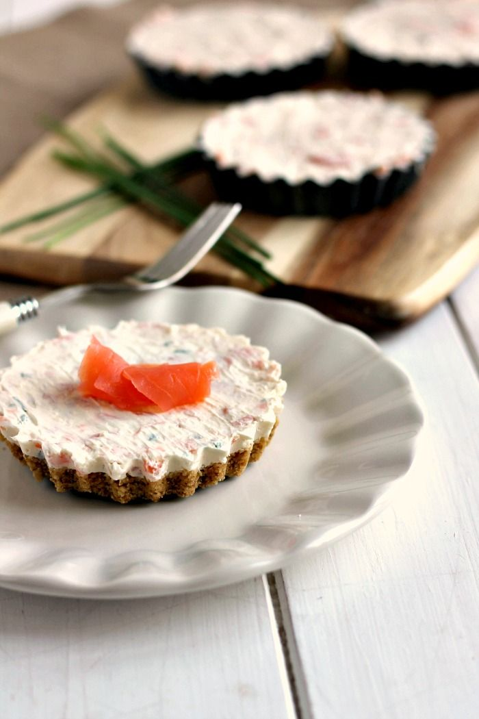Mini Smoked Salmon Cheesecakes with an oatcake base and cream cheese, smoked salmon and horseradish topping. Perfect for a make-ahead Christmas starter.