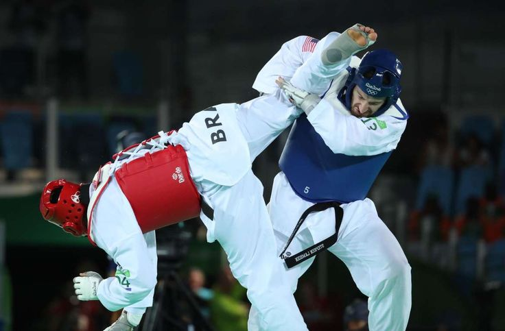Stephen Lambdin of the United States, right, competes against Maicon Siqueira of Brazil in the men's +80kg round of 16 taekwondo match during the Rio 2016 Summer Olympic Games at Carioca Arena 3.    -  Best images from Aug. 20 at the Rio Olympics
