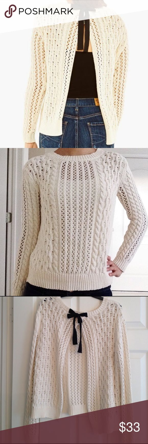 BETHANY MOTA CREAM RIBBON-TIE OPEN BACK SWEATER Great cream colour.. Crocheted sweater with black ribbon tie in the back which is open. A camisole or under later is required. In excellent condition. BETHANY MOTA Sweaters