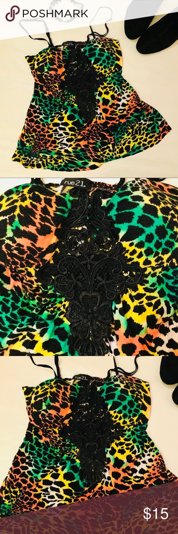 "Rue 21 Cami- Multicolored Animal Print Rue 21 Cami- Multicolored Animal Print with lacy embellished neckline and adjustable length spaghetti straps Beautiful, Bright and Fun!! 100% Rayon, Size Small LAY FLAT MEASUREMENTS (APPROX): Under Bust 13"", Length 17"" Rue 21 Tops Camisoles"