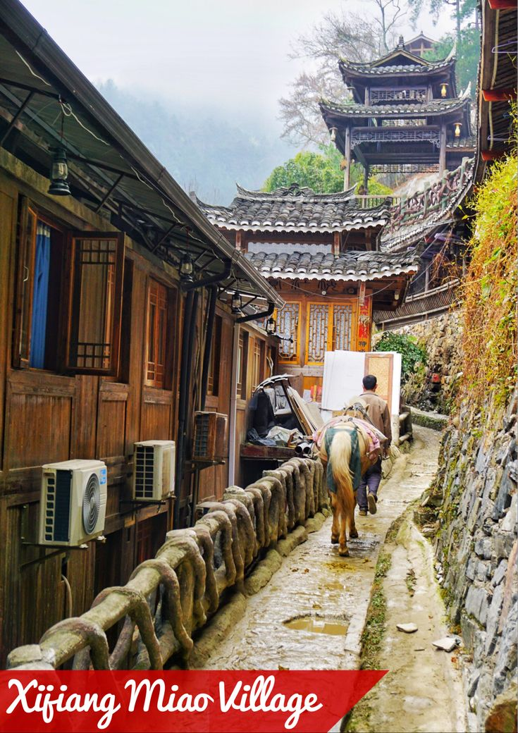 The Xijiang Miao Village in China, one of the most beautiful Chinese villages you'll ever see. Read all about it in this Xijiang travel guide.