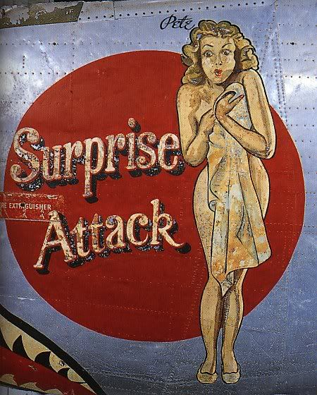 """Surprise Attack"" from the Confederate Air Force Collection.  This collection of nose art panels came to the CAF from Minot Pratt, the general manager of the company that was scrapping planes at the boneyard at Walnut Ridge, Arkansas.  He had ordered his men to cut out and save the most interesting nose art, which he was supposedly going to put up as a fence around his property.  This never happened and he donated the pieces to the CAF in the 1960's."