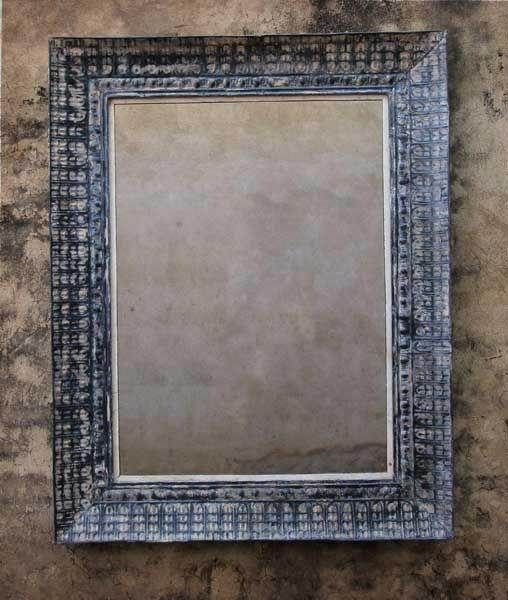 Mirror frame made up from old tin pressed ceiling panels.