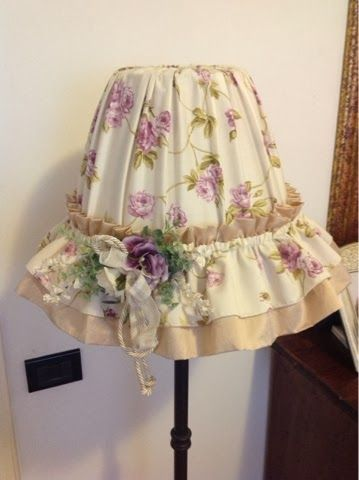 I like the elastic in the top and base of the shade with a small ruffle pointing up and a double ruffle like a skirt on bottom of the shade.