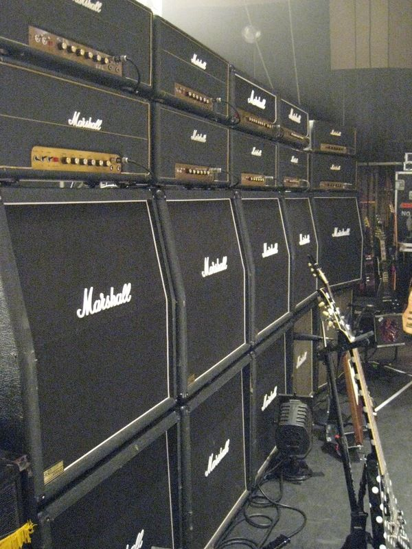 Marshall JCM800's 50w valve heads and 4x12 cabinets with Celestion 'greenbacks' inside. Makes the best noise with a Les Paul you'll ever hear.