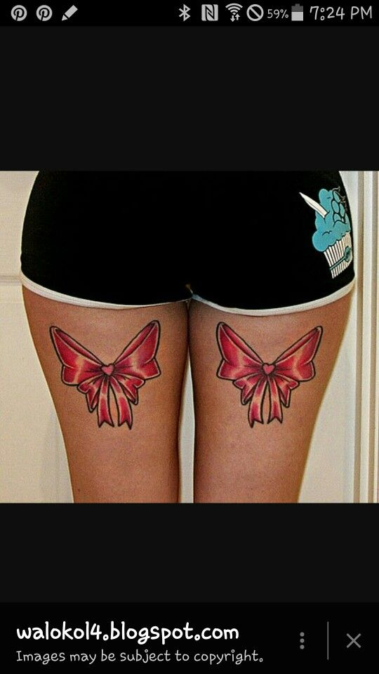 Red bow thigh high tattoo