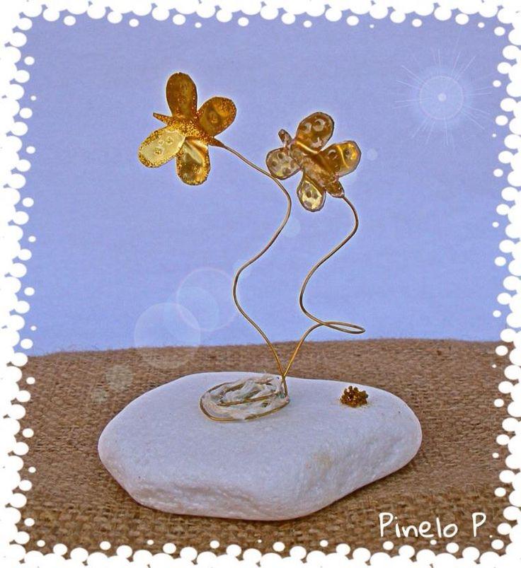 Golden butterflies on white stone! www.facebook.com/pinelokallitexnimata