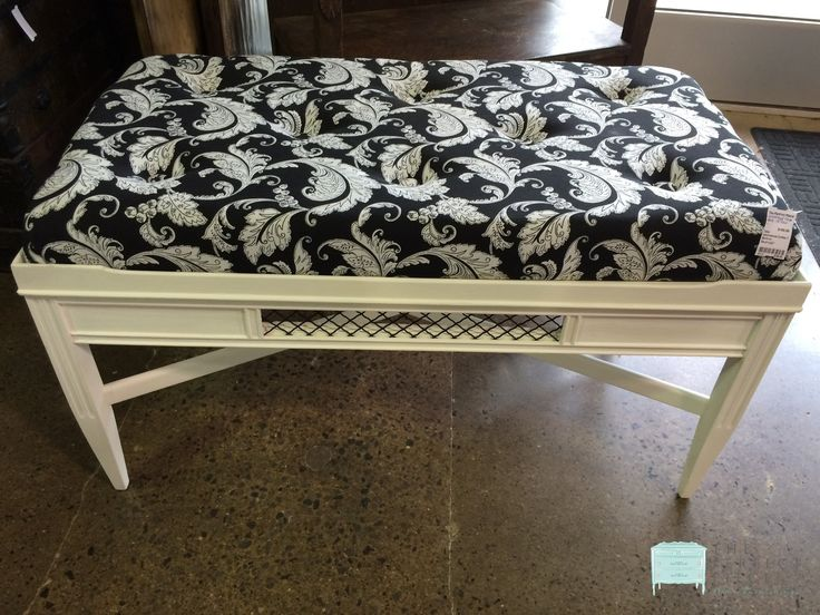 """This beautifully painted upholstered coffee table would be perfect in a family room or game room. The upholstered pad on the top makes it super charming and very functional for a family with children! The black & cream fabric is very chic and the piece is just really adorable. Dimensions are 39"""" x 21"""" x 22""""."""