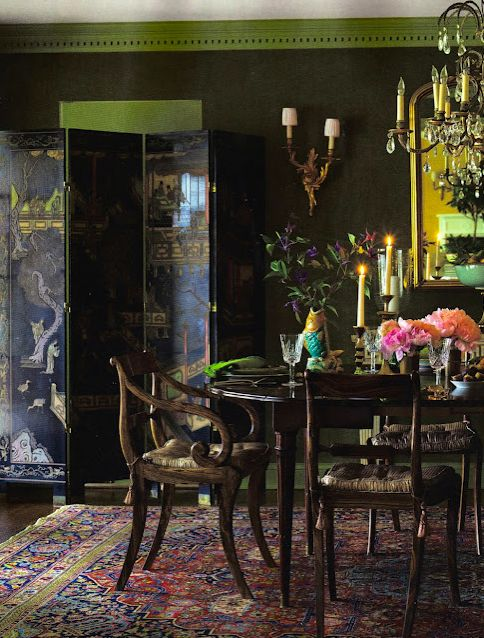 The screen , furniture, & rug are great, but would you really want to eat in a room with black walls.? Meg Braft