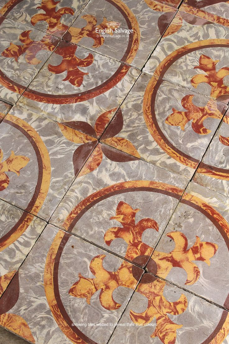 Reclaimed Encaustic Decorative Tiles In Grey Red And Yellow Repeated Fleur De Lys Circular Patterns Are Formed Of Four The Edging Tile