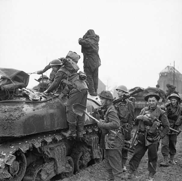 Infantry of 3rd Division climbing into Kangaroo personnel carriers prior to the attack on Kervenheim, 2 March 1945.