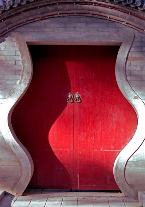 A Red Door in the Hutong, Beijing, China. This shape is a wealth gourd.  Imagine coming through this every day.