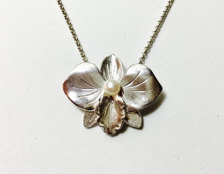 Orchid Sterling silver pendant with fresh water pearl. $85