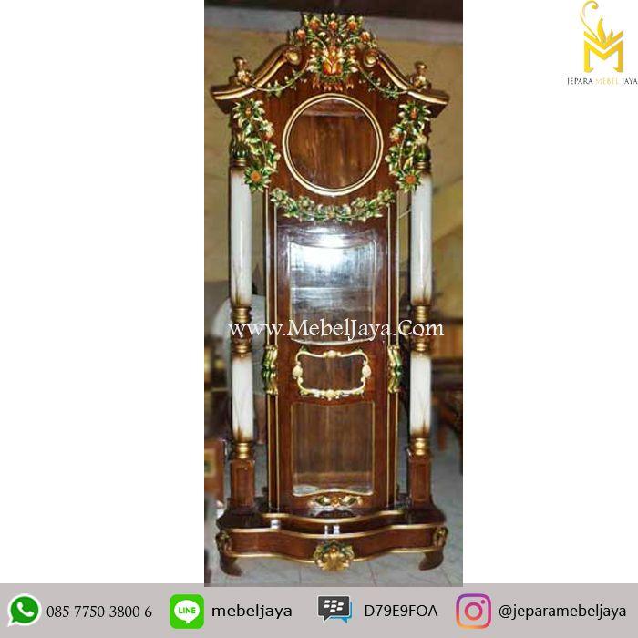 Lemari Jam Ukir Jati Klasik Mewah Jepara - Furniture Almari jam bandul dengan ukiran bunga warna dan di desain secara mewah dengan kualitas terbaik.