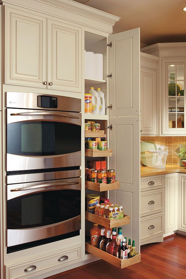 This pullout pantry cabinet has five rollout trays that can hold all of your favorite items in one location.
