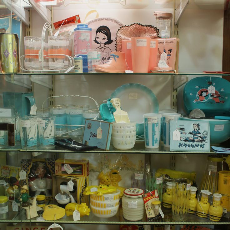 of mid century kitchen in turquoise pink and yellow vintage kitchen