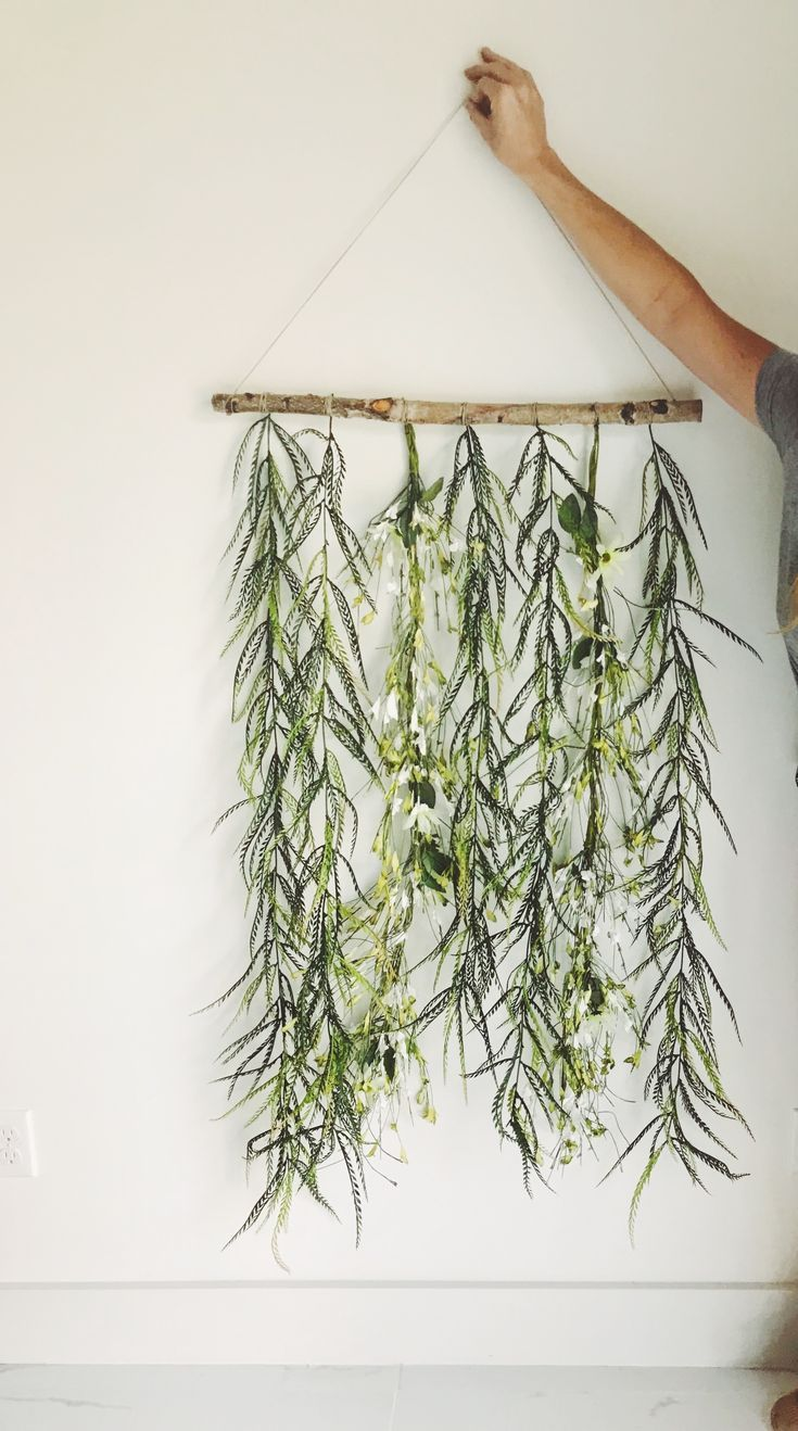 Easy DYI decoration of greenery and flowers hanging off a ... on Wall Sconces For Greenery Decoration id=21464