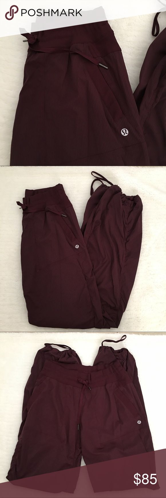 """Lululemon Burgundy Studio Pants size 8 Preowned authentic Lululemon Burgundy Studio Pants size 8. Inseam is 33"""" inches. Rise is 10"""" inches. Lightly worn. Side pockets. Please look at pictures for better reference. Thank you for looking and Happy shopping!!! lululemon athletica Pants"""