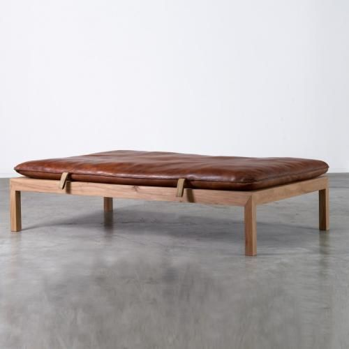 Industrial daybed designed by Indenfor & Udenfor. The daybed is composed of an old leather gymnastic mat from a French school and a frame made from old elm wood. The leather has a nice patina. This item is also available with a metal frame.