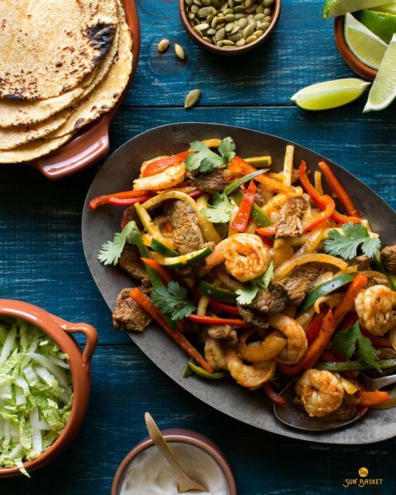 Fajitas are a family favorite in Chef Justine's house since they're so easy to customize to individual tastes. Here, while everything cooks together in one pan, at the table, seafood lovers can load up their tortillas with wild Gulf shrimp, while meat eaters can pile on the top sirloin steak strips—and omnivores can try a bit of everything. Our custom fajita spice blend brings layers of flavor to the shrimp, steak, and the many good-for-you vegetables. #soyfree
