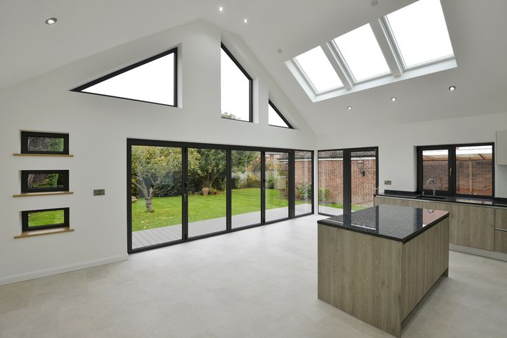 The clever use of glazing - folding sliding doors, roof lights and bespoke windows has opened up this living space