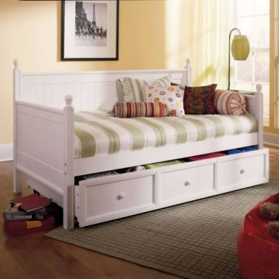 With its creamy white finish and subtle cottage style the Casey Daybed in White will bring a fresh cheerful accent to any room in your home. Option to choose no mattress or 1 free mattress. The sides and back are solid panels of wood with rounded wood finials atop each post. The Casey Daybed is great for spare bedrooms kids rooms or as an office-area sofa. This daybed comes with an optional roll-out trundle that can be used for extra storage or s