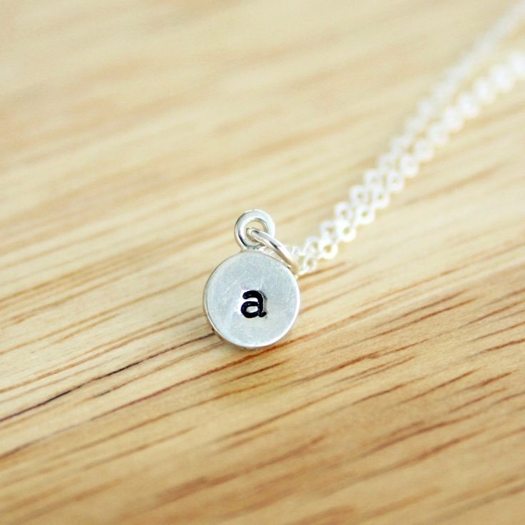 """Tiny personalized initial charm necklace. Show off your own initial, your spouse's initial, or your kids initials. This is the perfect necklace for the lady who is dainty and wears very simple jewelry. The charm is 1/4"""" across and is sterling silver. How to Customize: * Select the necklace length and number of charms. Click """"Add to Cart"""" * Select or enter your details in the pop-up window."""