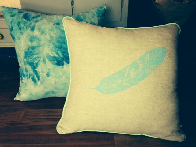 Original Screenprinted feather on linen cushion (icedyed cushion in background) Available from Vintage Coast Interiors