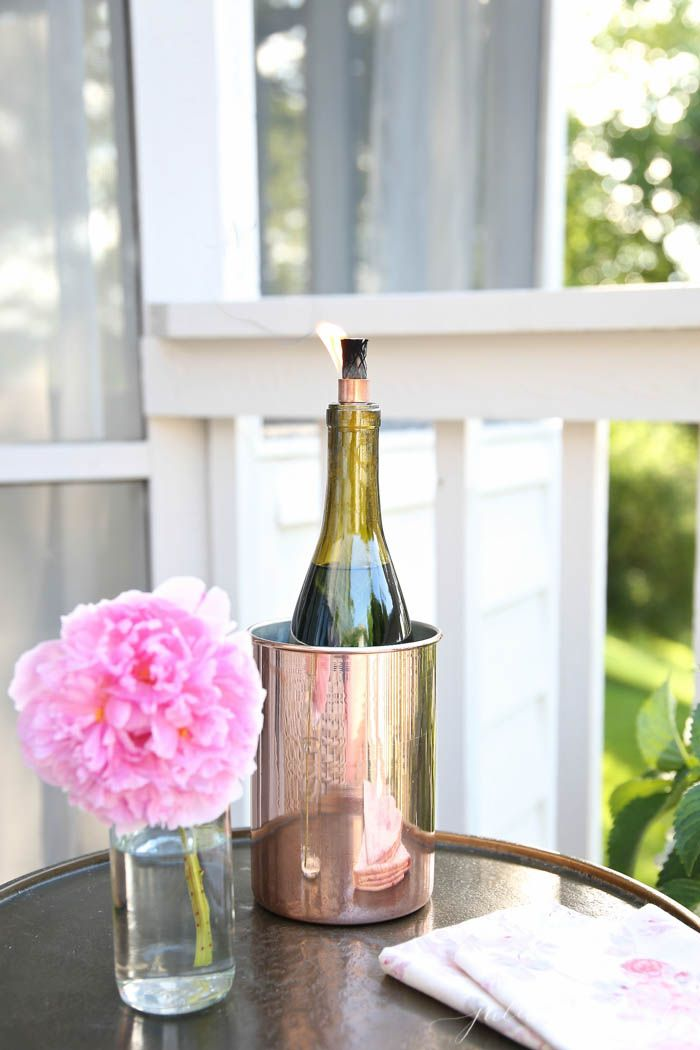 DIY Wine Bottle Tiki Torch | Add ambience while deterring bugs this summer with a tiki torch made from a wine bottle in less than 10 minutes... Totally making some of these for our new deck, and what a great excuse to drink more wine!!! via @Juli