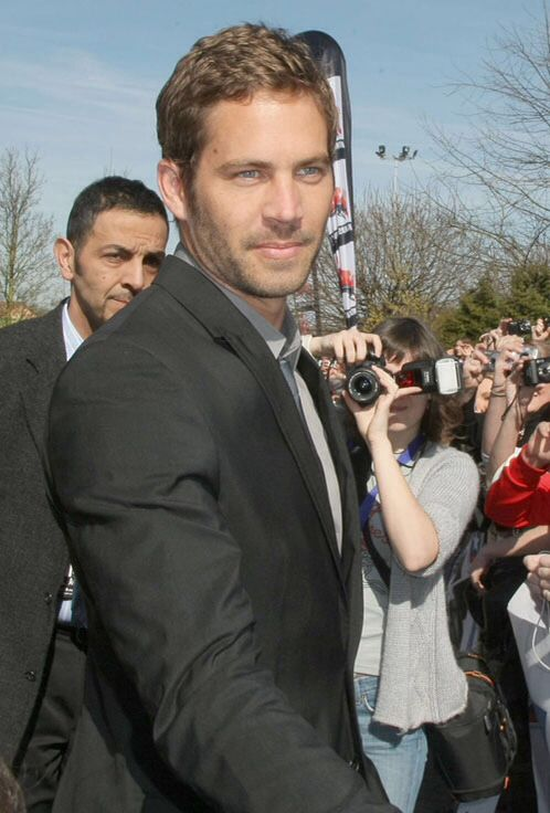 """Paul walker...... killed by a speeding red Porsche turning a sharp turn....not right..... video on yotube where his friend says the last words Paul said were """"I will be back in 5 minutes.""""......family devastated I bet.... R.I.P Paul Walker"""