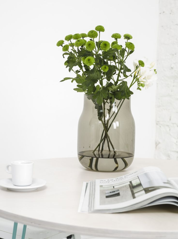 This smokey vase, designed by DECHEM, is hand-blown from Bohemian glass into beech wood moulds. Available exclusively at www.masterandmaster.eu