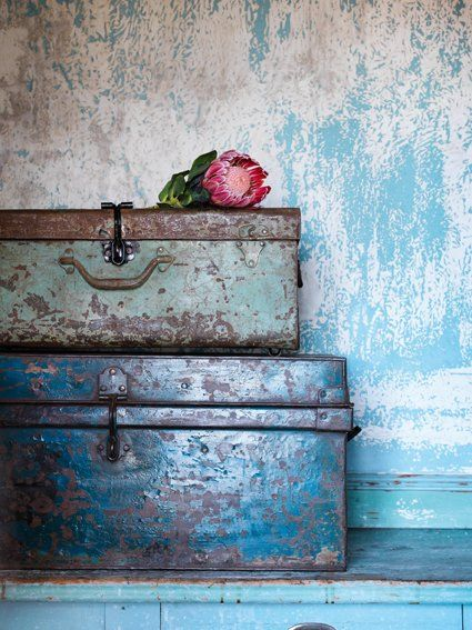 oh look over there on that old dresser...two old metal boxes...and one dried rose...wonder what we will find inside....