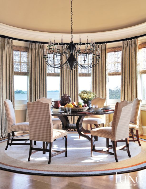 round table from john rosselli u0026 associates is paired with custom chairs and a remains lighting